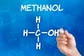 Hand with pen drawing the chemical formula of Methanol — Stock Photo
