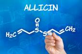 Hand with pen drawing the chemical formula of Allicin — Stock Photo