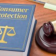 A law book with a gavel - Consumer Protection — Stock Photo #78537038