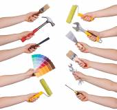 Woman holding redecorating tools isolated on white — Stock Photo
