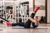 Woman showing Pilates exercises — Stockfoto