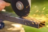 Angle grinder cutting metal — Stock Photo