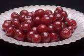 Sour cherry on a silver plate — Stock Photo