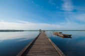 Wooden pier in a lake. Sunrise at Soustons, France — Стоковое фото