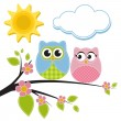 Two owls on the branch — Stock Vector #67418279