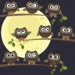 Night owls on branches — Stock Vector #72880217
