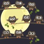 Night owls on branches — Stock Vector