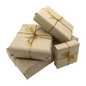 Gifts wrapped in brown paper — ストック写真