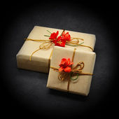 Gift boxes on a black background — Stock Photo