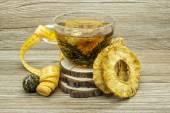 Dietary jasmine tea and dried pineapple — Stock Photo