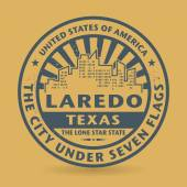 Grunge rubber stamp with name of Laredo, Texas — Stock Vector