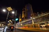 Night traffic and Christmas illuminations — Stock Photo