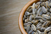 Sunflower seeds in bowl — Stock Photo
