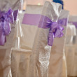 Wedding chairs with purple bow — Stock Photo #68141973