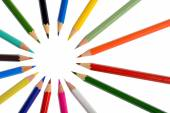 A circle of coloring crayons isolated on white background — Stock Photo