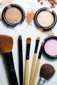 Broken powder, foundation and brushes — Stock Photo