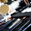 Make-up room and mix of brushes — Stock Photo #75359917