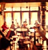 People in Coffee shop blur background with bokeh lights, vintage filter for old effect, blurred background — Stock Photo