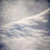 Winter background - Abstract bokeh lights and snowdrift — Stock Photo