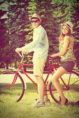 Together on a bike — Stock Photo