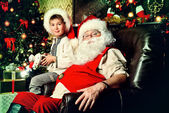 Kid and santa — Stock Photo