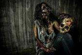 Zombie and skull — Stock Photo