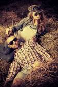 Couple in haystack — Stock Photo