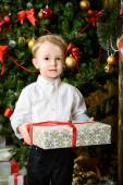 Boy and a present — Foto Stock