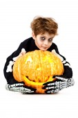 Lad and pumpkin — Stockfoto