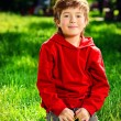 Sitting on grass — Stock Photo #63516411