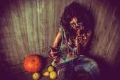 Zombi and pumpkin — Stock Photo