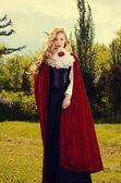 Red cloak girl — Stock Photo