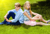 Sitting on a lawn — Stock Photo
