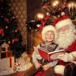 With santa — Stock Photo #74059489