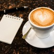 Open a blank white notebook, pen and cup of coffee on marble des — Stockfoto #54126279