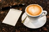Open a blank white notebook, pen and cup of coffee on marble des — Stock Photo