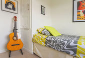 Bedroom with guitar in newly house — ストック写真