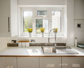 Kitchen in newly restored house — Stock Photo