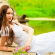 Young woman resting on the bridge of the river — Stock Photo #51819307