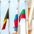 Four flags on flagpoles countries — Stock Photo #52347555