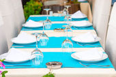 Beautiful tables with kitchenware in a summer cafe — Stock Photo