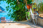 White bicycle parked near the sea — Stock Photo