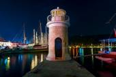 Night shot of the lighthouse on the pier — Stock Photo