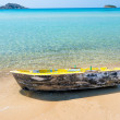 Beautiful turquoise sea and the old boat on the shore — Stock Photo #54220093
