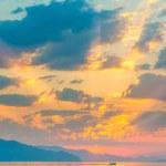 Beautiful cumulus clouds over the sea at sunrise — Stock Photo #55253133