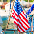 USA flag close-up set on a yacht in the port — Stock Photo #55865247