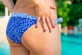 Women's hips closeup on background the pool — Stock Photo