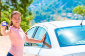 Young beautiful girl took a white car rental — Stock Photo
