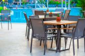 Outdoor cafes near the swimming pool at dawn — Stock Photo