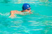 Athlete exercising in the pool outdoors — Stock Photo